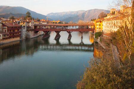 The Ponte Vecchio (or Ponte degli Alpini) bridge, and the Brenta river, on sunset, in Bassano del Grappa, Veneto, Italy