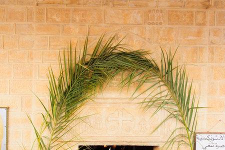 christianity palm sunday: NAZARETH, ISRAEL - APR 05, 2015: The door of the Greek Orthodox church of Annunciation, decorated for Palm Sunday, in Nazareth, Israel
