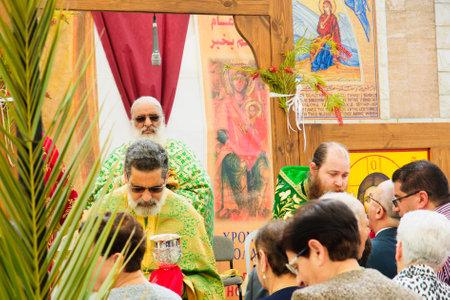 nazareth: NAZARETH, ISRAEL - APR 05, 2015: Orthodox Palm Sunday blessing ceremony, in the Greek Orthodox church of Annunciation, in Nazareth, Israel Editorial