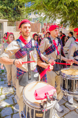 christianity palm sunday: NAZARETH, ISRAEL - APR 05, 2015: A parade, part of the Orthodox Palm Sunday celebration, in the Greek Orthodox church of Annunciation, in Nazareth, Israel