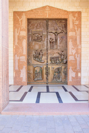 nazareth: NAZARETH, ISRAEL - APR 05, 2015: A decorated wooden door in the main entrance of the Church of Annunciation, in Nazareth, Israel