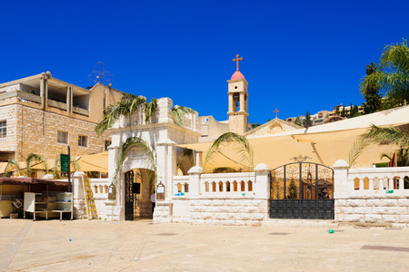 christianity palm sunday: NAZARETH, ISRAEL - APR 05, 2015: The entrance of the Greek Orthodox church of Annunciation compound, decorated for Palm Sunday, in Nazareth, Israel Editorial