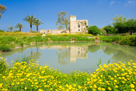 nature reserves of israel: A restored Crusader-era flour mill building, and a water pond, in En Afek Nature Reserve, northern Israel