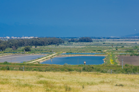 nature reserves of israel: Countryside and fish growing pools, viewed from Tel Afek, northern Israel