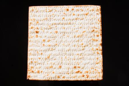 matzo: Matzo - A traditional Jewish Passover bread on a black background