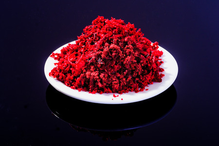 horseradish sauce: Horseradish sauce (with beet) - A traditional Jewish Passover dish. In a white plate on black background
