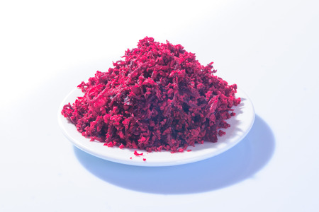 horseradish sauce: Horseradish sauce (with beet) - A traditional Jewish Passover dish. In a white plate on white background