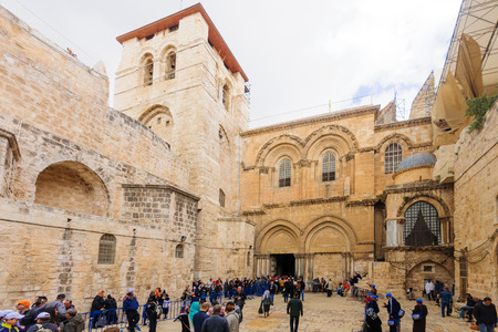 sepulcher: JERUSALEM, ISRAEL - APR 10, 2015: Pilgrims in front of the Holy Sepulcher Church on Orthodox Good Friday, in the old city of Jerusalem, Israel