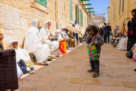 via dolorosa: JERUSALEM, ISRAEL - APR 10, 2015: A group of pilgrims wait near station 9 of the Via Dolorosa, on Orthodox Good Friday, in the old city of Jerusalem, Israel Editorial