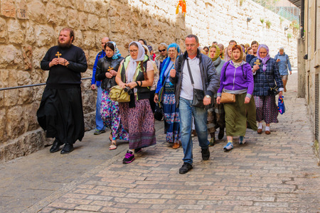 via dolorosa: JERUSALEM, ISRAEL - APRIL 10, 2015: Pilgrims from all over the world commemorating the crucifixion of Jesus Christ by carrying a cross along via dolorosa, on orthodox good Friday, in the old city of Jerusalem, Israel Editorial