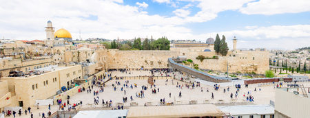 JERUSALEM, ISRAEL - APRIL 10, 2015: The Western Wall crowded with Passover prayers, and Al-Aqsa mosque and the Dome of the Rock in the background, in the old city of Jerusalem, Israel Editorial
