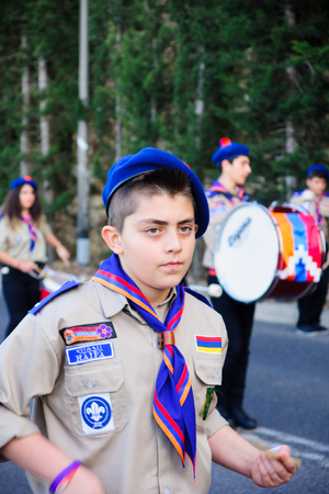 HAIFA, ISRAEL - APR 19, 2015: A group of Christian scouts takes part in the annual our lady of Mount Carmel parade, in Haifa, Israel. This annual event commemorates the hiding of Mary statue in WWI