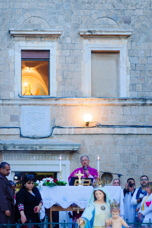 annual event: HAIFA, ISRAEL - APR 19, 2015: A blessing ceremony in the Stella Maris monastery, mark the end of the annual our lady of Mount Carmel parade, in Haifa, Israel. This annual event commemorates the hiding of Mary statue in WWI