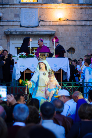 carmelite nun: HAIFA, ISRAEL - APR 19, 2015: A blessing ceremony in the Stella Maris monastery, mark the end of the annual our lady of Mount Carmel parade, in Haifa, Israel. This annual event commemorates the hiding of Mary statue in WWI
