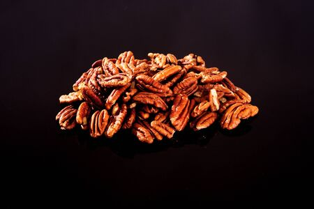 Pecan Nuts on a black background Stock Photo