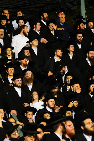 tefillin: MERON ISRAEL  MAY 06 2015: A crowd of orthodox Jews attend the annual hillulah of Rabbi Shimon Bar Yochai in Meron on Lag BaOmer Holiday. This is an annual celebration at the tomb of Rabbi Shimon