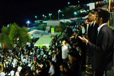 rabbi: MERON ISRAEL  MAY 07 2015: A crowd of orthodox Jews attend and dance the annual hillulah of Rabbi Shimon Bar Yochai in Meron Israel on Lag BaOmer Holiday. Editorial