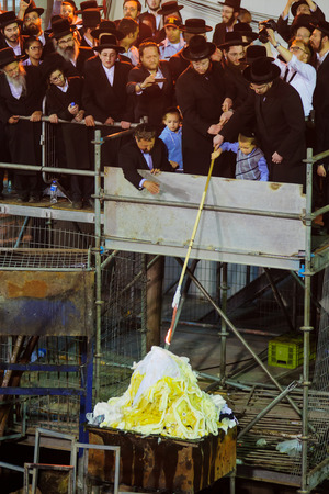 lag: MERON ISRAEL  MAY 07 2015: Orthodox Jews ignites the traditional fire at the annual hillulah of Rabbi Shimon Bar Yochai in Meron Israel on Lag BaOmer Holiday