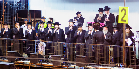 rabbi: MERON ISRAEL  MAY 07 2015: Orthodox Jews play music and sing to the dancing crowd at the annual hillulah of Rabbi Shimon Bar Yochai in Meron on Lag BaOmer Holiday