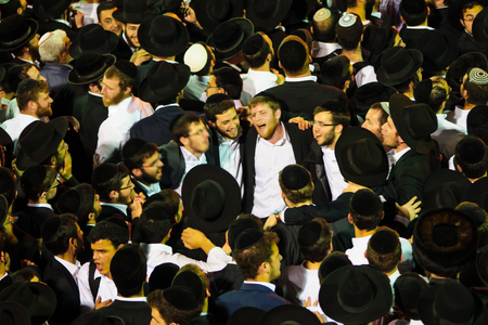 rabbi: MERON ISRAEL  MAY 07 2015: Orthodox Jews dance at the annual hillulah of Rabbi Shimon Bar Yochai in Meron Israel on Lag BaOmer Holiday. This is an annual celebration at the tomb of Rabbi Shimon