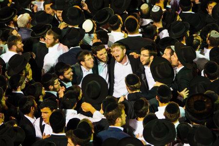 kabbalah: MERON ISRAEL  MAY 07 2015: Orthodox Jews dance at the annual hillulah of Rabbi Shimon Bar Yochai in Meron Israel on Lag BaOmer Holiday. This is an annual celebration at the tomb of Rabbi Shimon