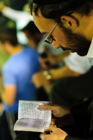 lag: MERON ISR  MAY 06 2015: An orthodox Jew read a prayer book at the annual hillulah of Rabbi Shimon Bar Yochai in Meron on Lag BaOmer Holiday. Its an annual celebration at the tomb of Rabbi Shimon