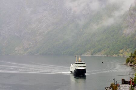 ferry boat: Ferry boat scene in the Geiranger fjord Norway