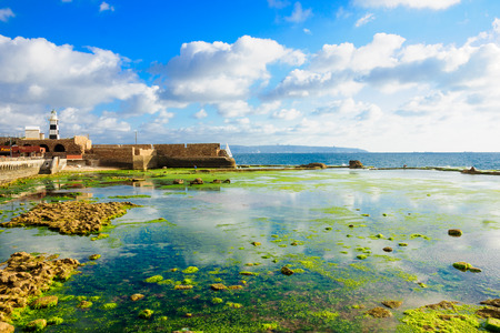 acre: ACRE ISRAEL  MAY 04 2015: Scene of a Templar Fortress remains lighthouse restaurants local fishermen and Haifa bay in the old city of Acre Israel Editorial