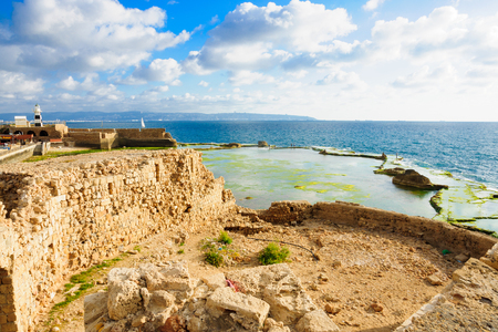 templar: ACRE ISRAEL  MAY 04 2015: Scene of a Templar Fortress remains lighthouse restaurants local fishermen and Haifa bay in the old city of Acre Israel Editorial