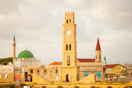 acre: Rooftop view of the old city of Acre at sunset with the clock tower minarets of Sinan Basha Mosque and AlJazzar mosque and other monuments. Acre Israel