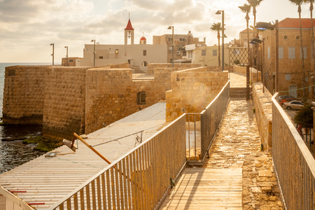 akko: St. John the Baptist Franciscan church and the sea wall promenade in the old city of Acre Israel