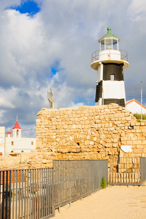 john the baptist: The lighthouse and St. John the Baptist church in the old city of Acre Israel Stock Photo