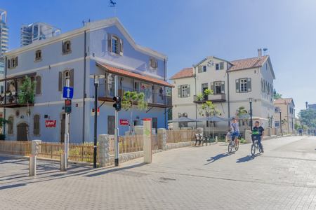 azrieli: TEL AVIV ISRAEL  MAY 15 2015: Scene of the Sarona compound with visitors in Tel Aviv Israel. Its a renewed Templar settlement turn into leisure and shopping complex.