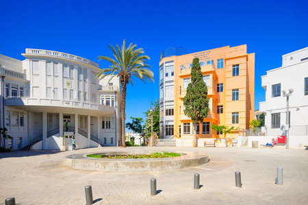 townhall: TEL AVIV ISRAEL  MAY 15 2015: Scene of the Bialik Square with visitors in Tel Aviv Israel. The Bialik Square was the home for the first townhall of TelAviv and is a great example of the modern Bauhaus architecture