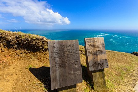 CAPE REINGA NEW ZEALAND  MARCH 30 2010: Information sign in Cape Reinga the meeting point of the Tasman Sea and the Pacific Ocean in the Northland North Island of New Zealand