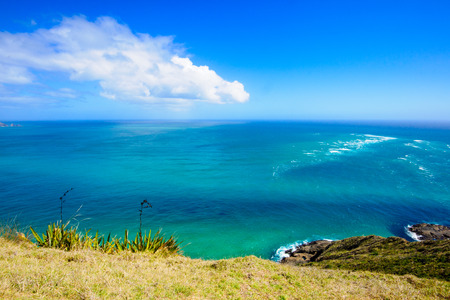 reinga: Cape Reinga the meeting point of the Tasman Sea and the Pacific Ocean in the Northland North Island of New Zealand Stock Photo