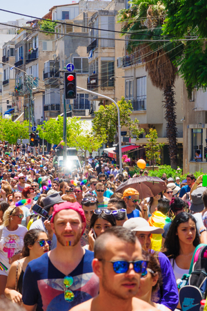 annual event: TEL AVIV ISRAEL  JUNE 12 2015: A crowd of people march in the Pride Parade in the streets of TelAviv Israel. Its part of an annual event of the LGBT community Editorial