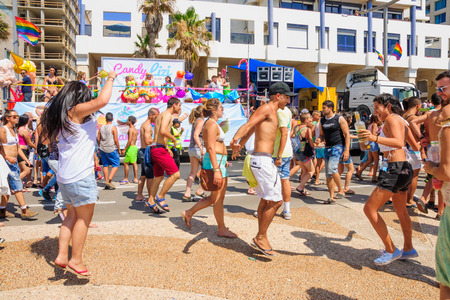 annual event: TEL AVIV ISRAEL  JUNE 12 2015: Dancers on a truck entertain the crowd in the Pride Parade in TelAviv Israel. Its part of an annual event of the LGBT community