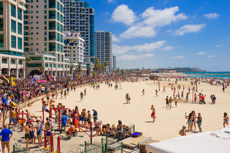 tel: TEL AVIV ISRAEL  JUNE 12 2015: View of the beach of TelAviv the old city of Jaffa and the crowd Pride Parade participants in TelAviv Israel. Its part of an annual event of the LGBT community
