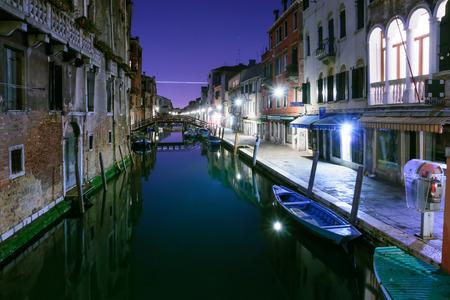 veneto: Canals and boats at night. In Cannaregio, Venice, Veneto Stock Photo