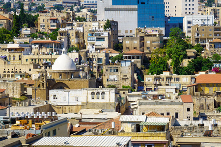 periods: HAIFA, ISRAEL - JULY 21, 2015: Rooftop view of downtown, with religious and commercial buildings from various periods, in Haifa, Israel Editorial
