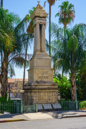 commemorating: A monument commemorating the building of the Hijaz Railway by the Ottoman Sultan in downtown Haifa, Israel. This monument is from the year 1905
