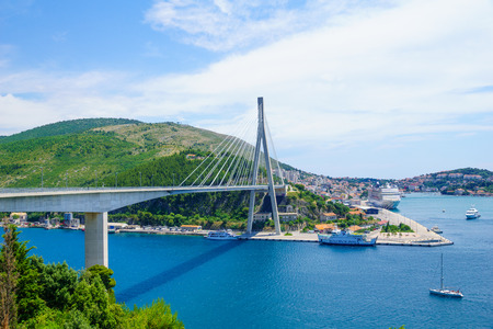 passenger ships: DUBROVNIK, CROATIA - JUNE 26, 2015: Scene of the Franjo Tudman Bridge, and the port of Gruz, with ferry boat, passenger ships and other vessels, in Dubrovnik, Croatia
