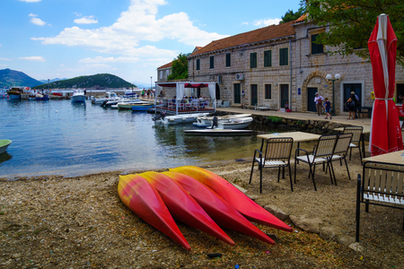 tranquilly: SUDURAD, CROATIA - JUNE 27, 2015: Scene of the fishing port, with boats, locals and tourists, in the village Sudurad, Sipan Island, one of the Elaphiti Islands, Croatia Editorial