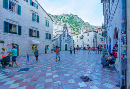 Luke: KOTOR, MONTENEGRO - JUNE 28, 2015: Scene of the Saint Luke Square and the church of Saint Luke, locals and tourists, in Kotor, Montenegro Editorial