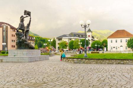 partisan: KOLASIN, MONTENEGRO - JUNE 30, 2015: Scene of Trg Borca square, with the Partisans Monument, locals and tourists, in Kolasin, Montenegro Editorial