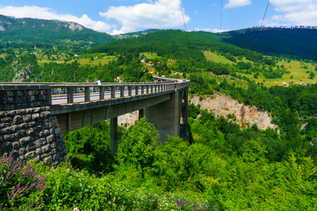 tara: BUDECEVICA, MONTENEGRO - JULY 02, 2015: Scene of the Durdevica Tara Bridge, across the Tara River Canyon, with locals and tourists, in northern Montenegro