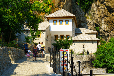 sufi: BLAGAJ, BIH - JULY 05, 2015: The Tekija, a Sufi Monastery, with locals and tourists, in Blagaj, Bosnia and Herzegovina Editorial