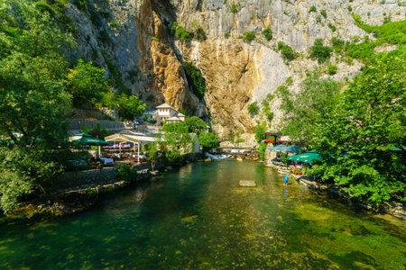 sufi: BLAGAJ, BIH - JULY 05, 2015: The Tekija, a Sufi Monastery, and the Buna River, with restaurants, locals and tourists, in Blagaj, Bosnia and Herzegovina Editorial