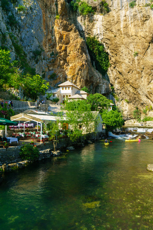 sufi: BLAGAJ, BIH - JULY 05, 2015: The Tekija, a Sufi Monastery, and the Buna River, with restaurants, locals and tourists, in Blagaj, Bosnia and Herzegovina Editorial